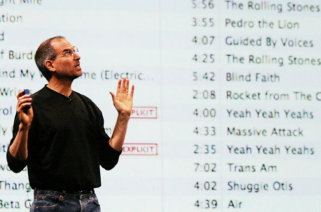 Apple CEO Steve Jobs gestures as he anno