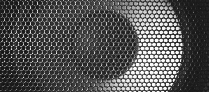 Detail shot of some round speakers. Speaker grill texture. Audio equipment.